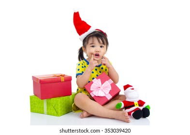 Little Asian girl in Santa hat and Christmas gift box isolated on white