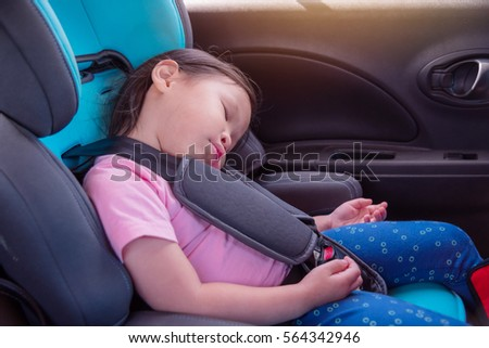 Little Asian Girl Sleeping On Car Seat In