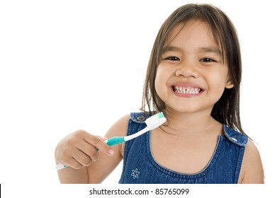 little asian girl with toothbrush over white background