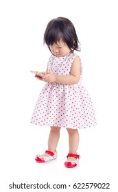 Little asian girl using smart phone isolated over white