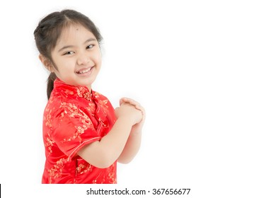 Little Asian girl wishing you a happy Chinese new year on isolated
