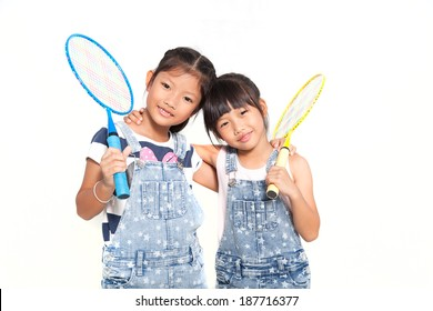Little asian girls with badminton isolate on white background