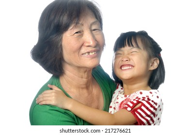 little asian granddaughter with her grandmother in the white background