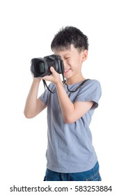 Little asian photographer taking photo over white background