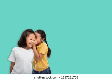 Little asian two girls laughing and smiling enjoy friendship tog
