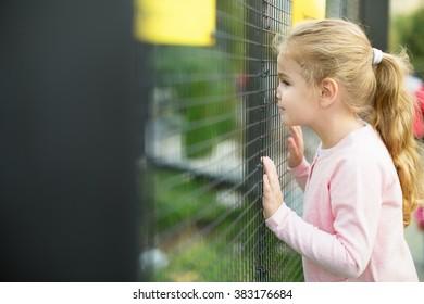 Little attractive girl in zoo