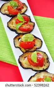 little aubergines appetizers with cherry tomatoes