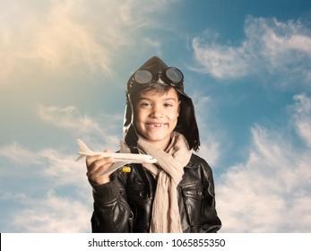 little aviator holding an airplane