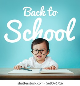 Little baby asian girl on blackboard with back to school, Education and preschool concept
