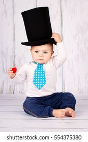 Little baby boy with big top hat