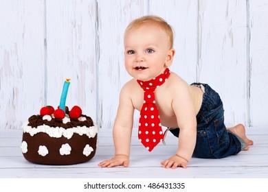Little baby boy with birthday cake