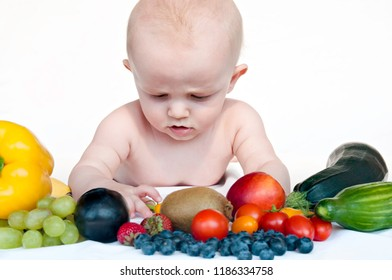 Little baby boy, fruits and vegetables