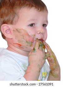 Little baby boy messy with fingerpaint