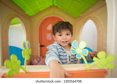 Little baby boy at play toy house