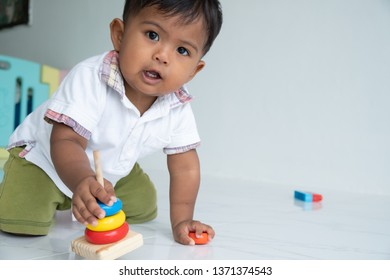 little baby boy play wooden toy at room