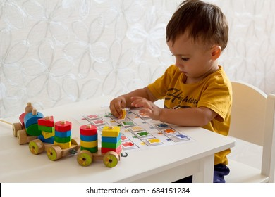 little baby boy playing board games