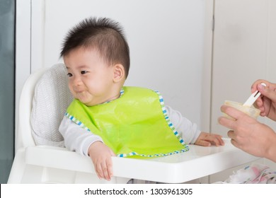 Little baby boy refuses to eat because eating full or not like food. Baby feeding problems concept