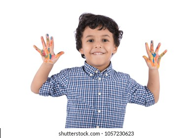 Little baby boy showing his dirty hands full of color and smile, isolated on a white background.
