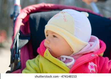 Little baby in the carriage outdoor