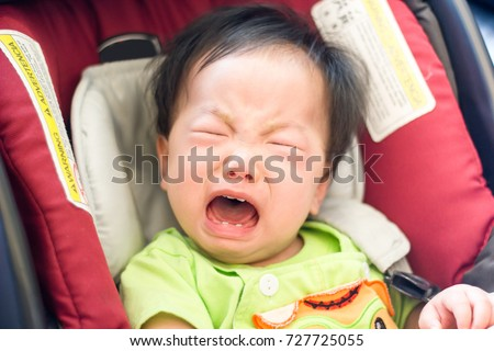 A Little Baby Cry Out So Loud While He Is Sitting In The Car Seat