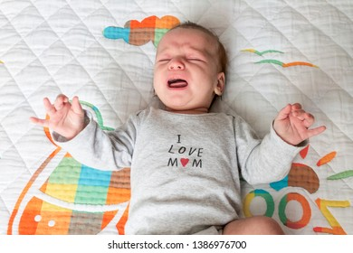 little baby crying in the bed, newborn colic
