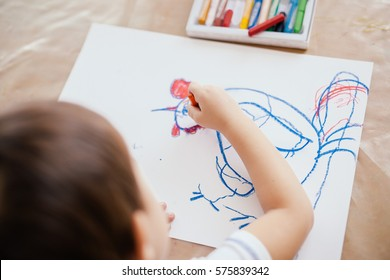 The little baby draws a painting