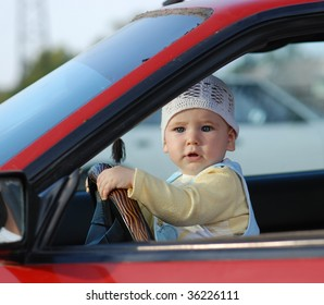 a little baby driving car
