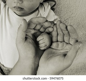 Little baby fingers in mother's hands. Classic monochrome photography.