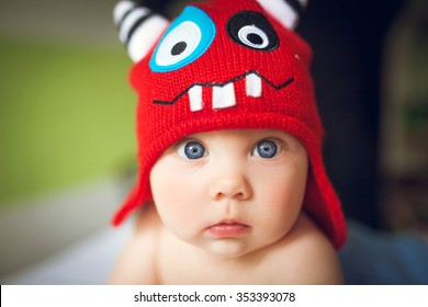 Little baby in a funny hat