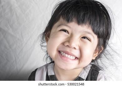 Little baby girl asian smilling face concept.