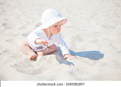 little baby girl crawling at the beach