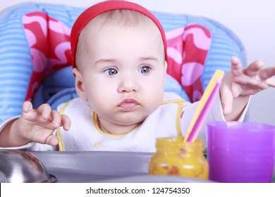 Little baby girl eats her first lunch