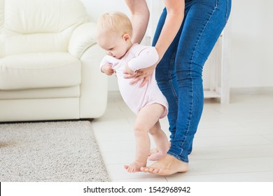 little baby girl first steps with the help of mom