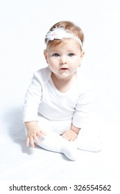 Little baby girl with gorgeous blue eyes isolated on white background
