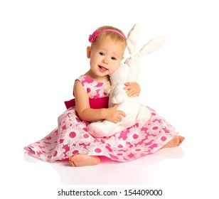 little baby girl hugging a  toy bunny rabbit isolated on white background