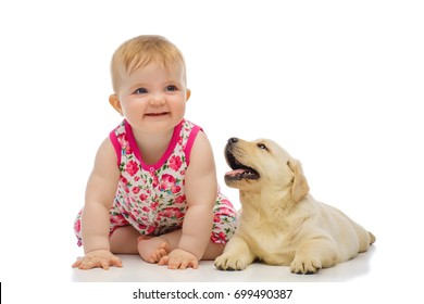 Little baby girl with labrador puppy, isolated on white