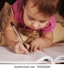 little baby girl learns to write (development, training, education concept)
