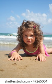 Little baby girl on the beach