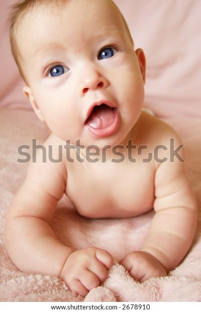 Little Baby Girl on Blanket looking up - taken closeup