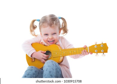 little baby girl playing guitar