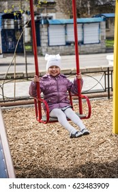 little baby girl playing at the Playground