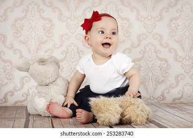 Little baby girl playing  with plush toys