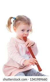 little baby girl playing recorder