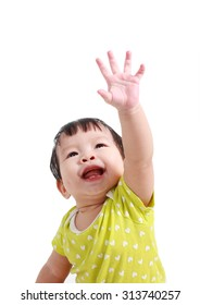 Little baby girl pulling hand up isolated on white background