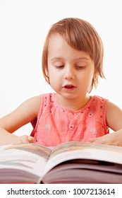 little baby girl reading a book (development, training, education)