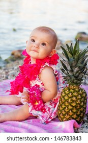 Little baby girl resting on the beach