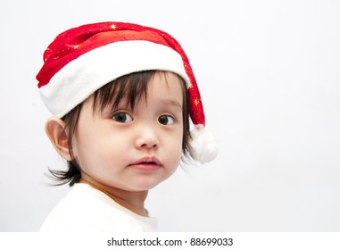 Little baby girl and Santa's hat