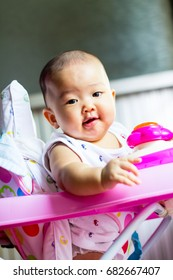 the  little baby girl standing  in Car Toy pink color