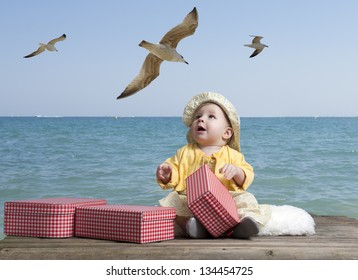 little baby girl with vintage suitcases on an old wooden raft floating in the sea, seagulls above her head