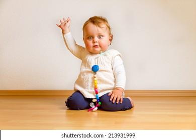 Little baby girl waving